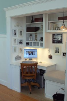 Dream office space, I love the sitting space beside the desk and the cubbyholes for sorting mail.  I am such a sucker for organization and built ins.
