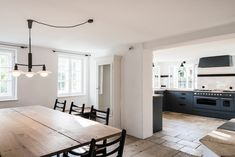 Black kitchen cabinets, germany, german, clean, modern and rustic, farmhouse remodeled.