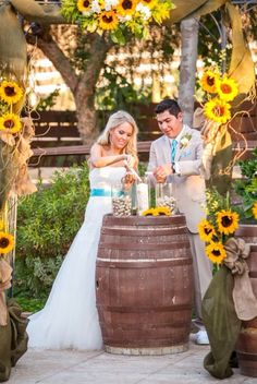 This picture has everything I want for my wedding; rustic, sunflowers, and a hint of blue