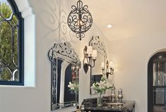 Hand forged iron custom wall sconces and pendant lights created by www.haciendalights.com