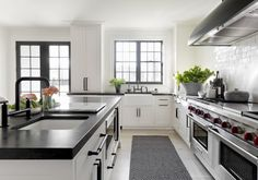 Love the windows painted black, find the black countertops stark, would do grey soapstone instead
