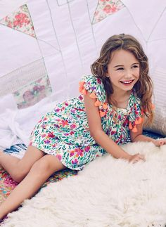 The Chloe Dress is sure to catch your eye- with its vibrant print and breathable material; perfect for your little one. The unique fabric and boho-chic tassels are sure to be a memorable addendum to your summer memories.