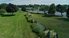 A history of one small island set among the rapidly flowing waters of the Rivière des Mille-îsles. Small Island, Le Moulin, Golf Courses, Track, Country Roads, Water, Gripe Water, Runway, Truck
