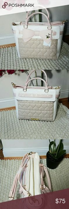 Betsey Johnson Belted Bow Tote BJ beautiful bow tote features a quilted heart pattern front and back. It also has,a belted bow across the front.  Can be carried as a handbag or as a shoulder bag.   Removable and adjustable strao. Gold hardware  Measures approximately 11.5 in x 16 in Pink/White/Sand Betsey Johnson  Bags Totes