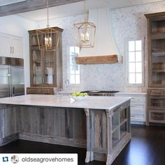 Great looking kitchen by @oldseagrovehomes #chandelierdevelopment #oldseagrovehomes #whitemarble
