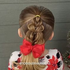 "[-VIDEO TUTORIAL-] ""Pull-through braid Christmas tree""  Here's a fun Christmas style to try this holiday season! It's a simple pull-through braid shaped like a Christmas tree! The lower you go on the braid, the more ""pancaking"" you'll do, so it'll be much wider at the bottom! Add mini ornaments or a star on top for even more flair OR keep it simple like us!"