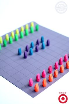 Kids can make their own board game using inexpensive school supplies for game pieces.