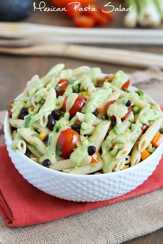 A simply delicious side dish, Mexican Pasta Salad - with black beans, corn, bell pepper, cilantro, tomatoes, and an avocado dressing.