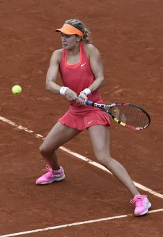 Canada's Eugenie Bouchard returns to Germany's Angelique Kerber during their French tennis Open round of sixteen match at the Roland Garros stadium in Paris ...