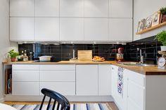 Hogar diez: Elegante apartamento con toques de color