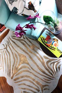metallic zebra print rug + teal love seat