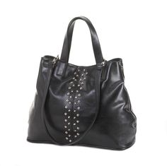 """Armchair Reader Civil War Book. Take the expressway to undeniable style with this gorgeous tote on your arm. The black leatherette construction, oversize design, and stud detailing will make this your go-to bag for day and night.  Item weight: 1.2 lbs. 17'"""" x 6"""" x 17"""" high. Polyurethane and fabric lining.  UPC: 849179017934."""
