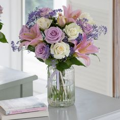 Divine floral display with vase £26 NEXT - every Mum would love these