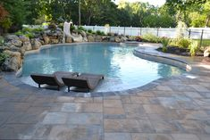 """Cambridge Paver Patio: The handsome patio/pool surround is made with durable Cambridge Ledgestone XL """"Toffee Onyx Light"""" pavers (Sherwood Collection). These pavers come in 3-piece design kits for a beautiful random design.  http://deckandpatio.com/in-ground-pool-with-spillover-spa-theres-more-than-one-way-to-make-a-splash/"""