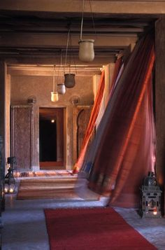 Moroccan hallway in a beautiful red - amberlair.com #boutiquehotel #travel #hotel