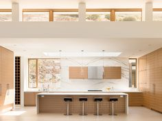 This kitchen features a large island, with plenty of room for food preparation, and also has room for seating.