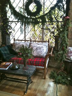 Beautiful woodsy Christmas decor with lots of greenery and of course some tartan.