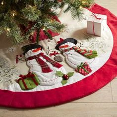 Sweet snowmen appliques are perched on the bold red trim of our adorable tree skirt. With a fun, wintery design, this piece puts the cherry on top—actually on the bottom—of a perfectly decorated tree! Xmas Tree Skirts, Christmas Tree Skirts Patterns, Diy Christmas Tree Skirt, Slim Christmas Tree, Christmas Stocking Hangers, Pretty Christmas Trees, Christmas Snowman, All Things Christmas, Christmas Stockings
