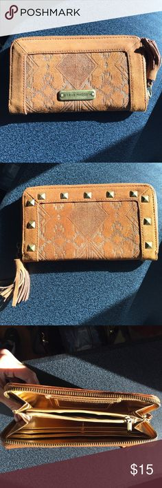 Steve Madden Gold Studded Wallet NWOT.  * Stylish Aztec design with gold studs around the edge on suede surface. WALLET/WRISTLET.  * Can fit a phone the size of a iPhone 6 and iPhone 7 inside, eyeliner, mascara, chapstick, and pen!!  * 4 card holder slots. Coin slots in the middle.  * 1 ID card holder.  * 4 slots to hold cash, receipts, cards, & etc!! Steve Madden Bags Wallets