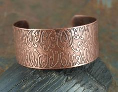 Salt water etched copper cuff with a Zentangle pattern.