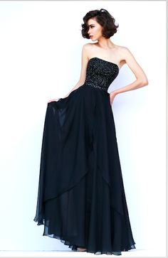 Style 1941 Swirls of leaf shaped stones accentuate the strapless bodice of this layered full length chiffon gown.