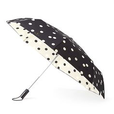 In a fun polka dot pattern, this super cute Kate Spade New York Travel Umbrella is perfect for the girl on the go. This umbrella is made with double layered nylon, is collapsible and it folds up to tuck snugly into your purse, tote bag, suitcase, or backpack for convenience and style. This one is so stylish, you'll want to plan a trip to Paris during rainy season just so you can use it.