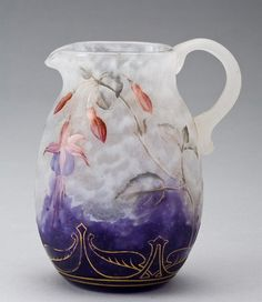 Beautiful glass vases and pitchers by Les frères Daum from the 1800s.