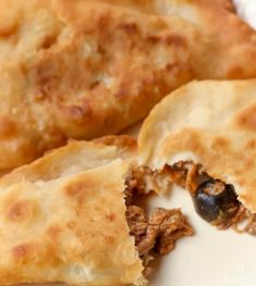 Our favorite Mexican dish - Beef Empanadas in Red Chili sauce. This crispy, airy taco made from dough and filled with red chile sauce, shredded beef, and olives is one of our favorite Mexican recipes! Beef Empanadas, Empanadas Recipe, Taquitos Recipe, Mexican Empanadas, Homemade Taquitos, Salsa Recipe, Mexican Dishes, Mexican Food Recipes, Ethnic Recipes