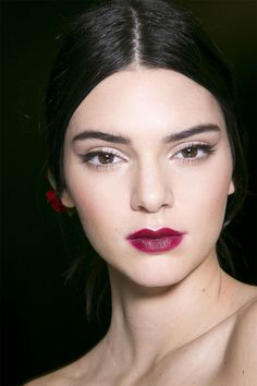 Berries and wine stained lips, clean lines on the eye and a perfect cat eye flick, this is a fabulous look for day or night