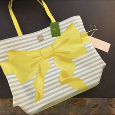 """Kate Spade Bow Tote Coated canvas; 14-karat gold plated hardware 13.5""""(W) x 15""""(H) x 5""""(D) Mesh bottom with zip around closure for releasing sand Open top Lined interior features 1 zip and 2 mesh slip pockets kate spade Bags Totes"""