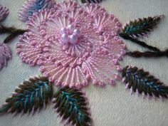 ELLA'S CRAFT CREATIONS embroidery enhanced by a few beads.