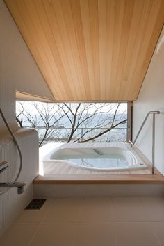 modern take on a Japanese soaking tub/shower room. Love the ceiling and the bather's-eye-view.