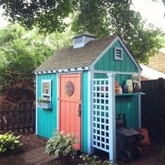 Garden Shed - I made the trellis and put a vintage cupola with weather vane on top of my shed - then added some color!