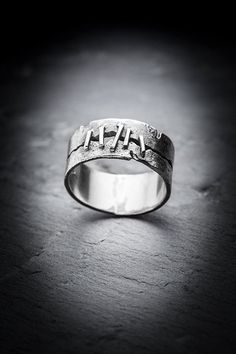 Melted, distressed silver band with a stitched up gash. Fives stitches on the top of band. Even width all around is 1 cm. Please order a 1/2 size