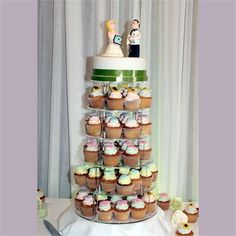 The couple decided to go non-traditional with their wedding cake and decided on a tower of iced cupcakes, with vanilla, chocolate and lemon flavours. Create by The Pink Sugar Cake Company in Limerick, the icing was shaped into pretty vintage brooches and sunflowers to be in keeping with the theme and then topped with a cutting cake. The cake toppers were designed to look just like the couple with Keith even wearing his chef's uniform.