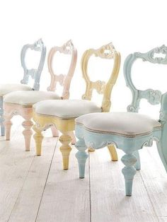Hand carved wooden chairs in varying pastel colourways