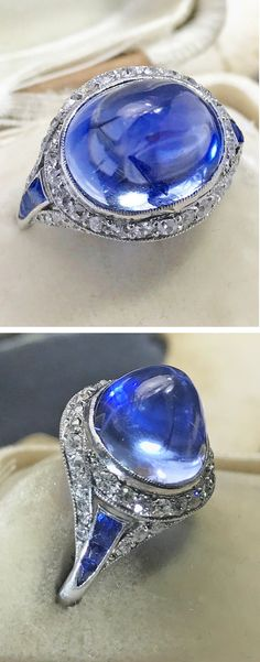 An Art Deco platinum, Ceylon sapphire and diamond ring, 1925-30. Set to the centre with a Ceylon sapphire cabochon weighing approximately 10.5 carats. #ArtDeco