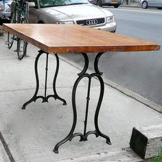 Love the use of reclaimed sewing machine legs on this piece.  The wrought metal makes a delicate addition to the solid wood top.