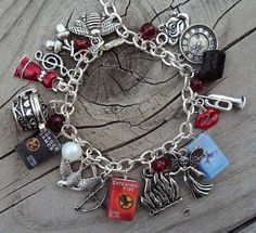 Hunger Games bracelet - how does she make these little book charms - seriously!?!