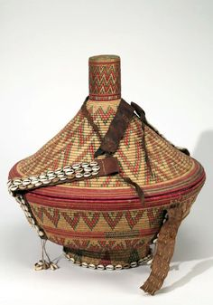 Africa | Basket with lid from the Amhara people of Ethiopia | Plant fiber, cowrie shells, leather, cord and dye | ca. 1967