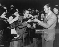 Clark Gable signing autographs -c.1937