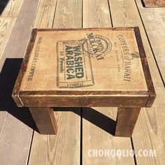 Recycled pallet wood table with Hawaiian coffee bean burlap bag--we have this exact Molokai bag in stock.
