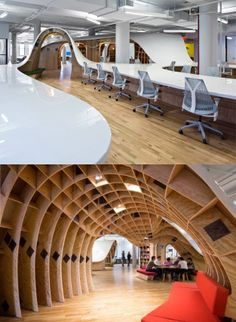 """1,100-foot long continuous desk runs through and around the Barbainian Group's 23,000 square-foot office. The """"superdesk"""" provides a work place for all 125 of the agency's employees. The endless table also includes seven archways which create communal spaces that serve as meeting rooms and alcoves that people can use to take a break from being at their desks."""