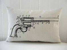 Revolver Gun Diagram silk screened cotton canvas throw pillow 12x18 black. Vintage image of a gun hand silk screened on 100% cotton canvas in ivory using black eco friendly water based paint.