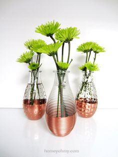 Glass bud vases with a dipped metal look using copper spray paint.