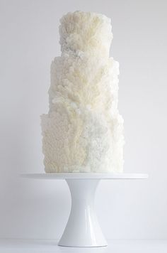 Beach wedding, anyone? This white cake by Maggie Austin features rice paper scales ideal for brides and mermaids!