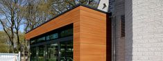 Trespa is a premier developer of high quality HPL panels for exterior cladding, decorative façades and scientific surface solutions. Composite Cladding, Exterior Cladding, Construction, Facade, Multi Story Building, Country, House, Club, Wood
