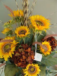 Silk floral arrangement with sunflowers.
