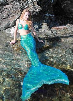 I don't know what mermaid this is, but it looks like she is wearing a beautiful homemade tail! I love it when mers make their own unique tail!