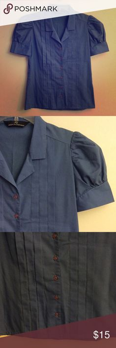 """Vintage Blouse Blue button-down collared pleated vintage MJ concepts in sportswear shirt with puffed short sleeves. Underarm to underarm is approx 18"""" across And shoulder to hem is approx 23"""" length MJ Concepts in Sportwear Tops Button Down Shirts"""